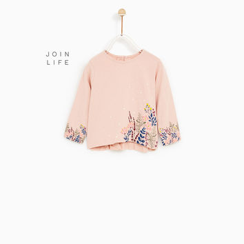 T-SHIRT WITH RAISED FLORAL PRINT