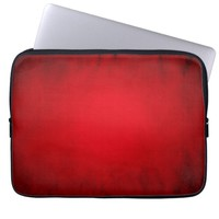 Red glowing spotlight laptop sleeve