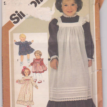 Vintage 1980 pattern for colonial style long sleeved dress and pinafore knee or ankle length toddler girl size 3 Simplicity 6184 UNCUT