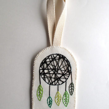 Fabric dreamcatcher modern wall hanging or Christmas ornament hand embroidered geometric design with light and dark green and black colors