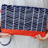Handmade designer fabric Chevron / Herringbone Wristlet / Clutch / Cosmetic Case in Navy Blue and Coral / Orange