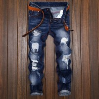 Ripped Holes Slim Weathered Strong Character Jeans [1922680422493]