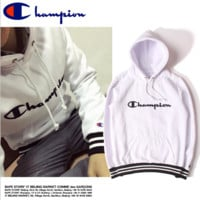 Champion Title sets more men and women lovers students hooded White