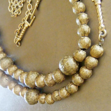 """Vintage 1970s Necklace with Engraved Basket Weave Designs Opera Length Metal Beads 28"""" Gold Tone Monet? Napier?"""