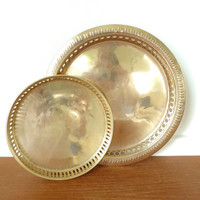 Two round brass gallery trays measuring 10 1/2 and 7 inches wide