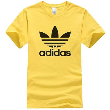 Adidas Summer New Fashion Letter Leaf Print Women Men Leisure Top T-Shirt Yellow