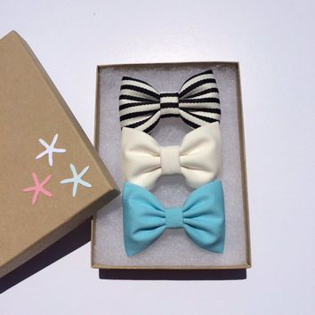 Striped, tiffany blue, and winter white bow lot from Seaside Sparrow.  Perfect beachy birthday present for any girl.