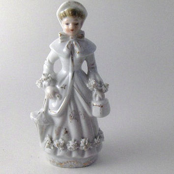 Vintage Porcelain Collectible Figurine: Lady with Spaghetti Trims, Umbrela and Bag.