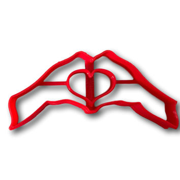 Hand making Hearts Cookies Cutter