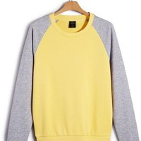 Light Yellow Collision Color Raglan Sleeve Sweatshirt$44.00