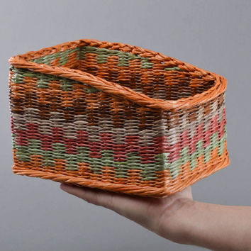 Handmade designer bright colorful decorative basket woven of paper tubes