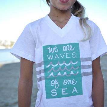 UNITY QUEST SERIES: White V-Neck T-Shirt with Waves Design in Ocean Blue