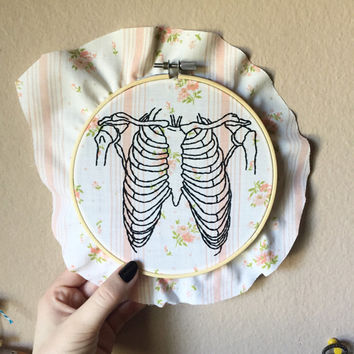 Rib cage hand embroidery on floral fabric, human skeleton art, 6 inch hoop