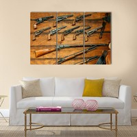Display Of Old West Guns And Rifles Multi Panel Canvas Wall Art