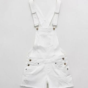 Loose white fringed strap worn shorts adjustable shoulder strap romper