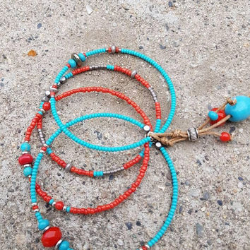 Boho Beaded Bangle Set with genuine red coral, turquoise magnesite, pyrite and metal beads lashed together with cord and bead charms