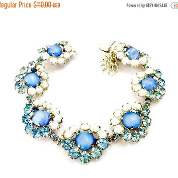 Blue Rhinestone White Milk Glass Bracelet, Seven Florete Shaped Links, Blue Moon Glow Center Cabs, Silver Tone, Vintage Wedding Jewelry