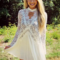 Our Modern Love Lace Dress is perfect for date night! It has a see through floral lace top paired with a gauze white skirt, long bell sleeves, and a keyhole front and back. Pair this dress with a bandeau or one of our dress extenders for an elegant