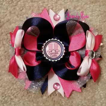 Pink and Navy Blue Boutique stacked hair bow, silver glitter tulle, gems, and a bottle cap with an image of cowgirl boots Cowgirl cutie