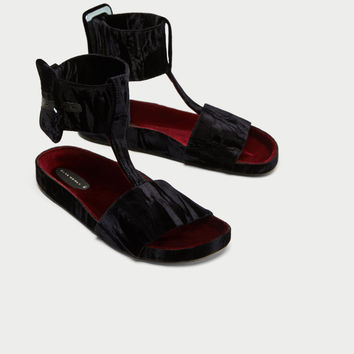 VELVET SLIDES WITH ANKLE STRAP DETAILS