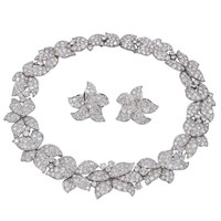 Collection of Helene Arpels Superb Diamond Platinum Flower Necklace and Ear Clip