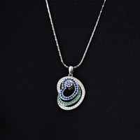 Magic Pieces Woman's Rhodium Plated Spinning Triple Hearts CZ Paved Pendant Necklace Multicolored