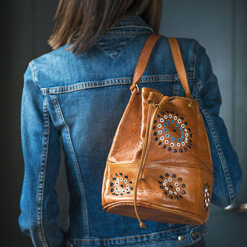 Vintage boho bucket bag tan. Genuine leather bucket bag floral pattern rivets. Small pockets around bag soft leather. Hand crafted women bag