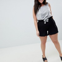 ASOS DESIGN Curve culotte shorts with paperbag waist at asos.com