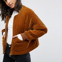 Weekday Velvet Quilted Bomber at asos.com