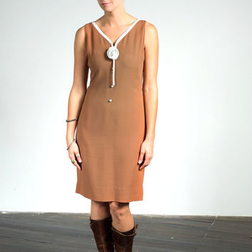 Vintage 1960s Sa'bett brown rayon crepe sheath dress with rosette and buttons, medium