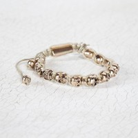 Brandy ♥ Melville |  Cream wrapped gold skull bracelet - Accessories
