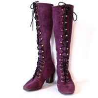 purple a go go. vintage 60s purple knee high lace up go go boots. size 6