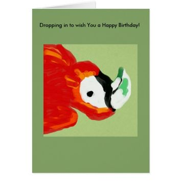 upside down red and orange parrot on a green card