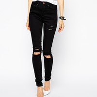 ASOS Ridley High Waist Ultra Skinny Jeans in Clean Black with Thigh Rips and Busted Knees at asos.com