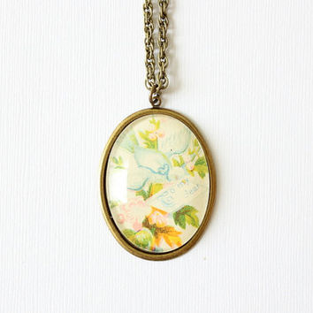 Victorian calling card jewelry.  Necklace made with romantic victorian bird and flowers.  Pastel colors.