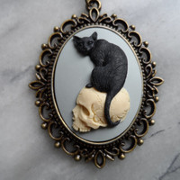Black cat on a skull cameo necklace. Great for the witch in you.