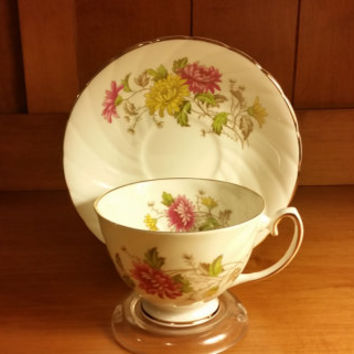 Royal Taunton Teacup and Saucer with Chrysanthemum Flowers in Swirl Pattern with Gold Trim