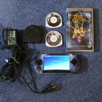 SONY Handheld PSP-1001 Video Game System 2 Games 32 MB Memory Card Battery Pack