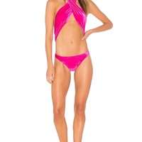 Sauvage Twisted One Piece in Fuchsia | REVOLVE