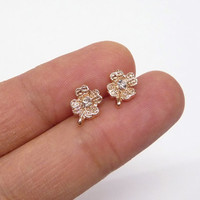 A rose gold plated four leaf clover earrings, A minimalist earrings, A cartilage/tragus ring