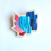 Abstract mineral brooch gem inspiration hand embroidered in ombre blues with pink and lavender on cream muslin and cream felt OOAK
