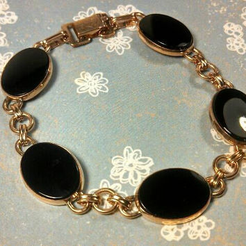 "Fabulous Onyx and 12K GF link bracelet. Oval  black cabs set in gold. 7"" long. 5 stones."