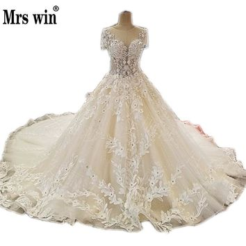 Wedding Dress 2017 New The High-end Short Sleeve Elegant O-neck Luxury Sweep Train Ball Gown Princess Sexy Illusion Bridal Gown
