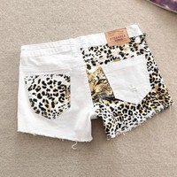 A 073001 zz Stitching Slim hip sexy leopard small hole shorts from Eternal