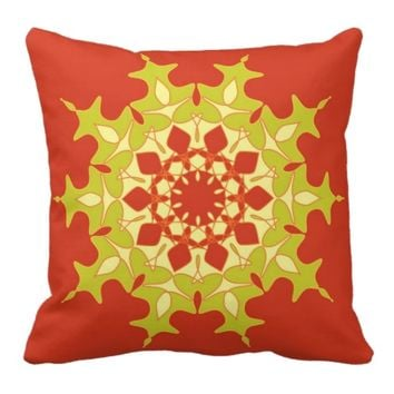 Green mandala on orange throw pillow