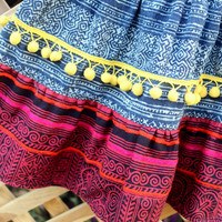 Little Girls Skirt Ethnic Hmong Cranberry and Indigo Batik With Bright Yellow Pom Poms