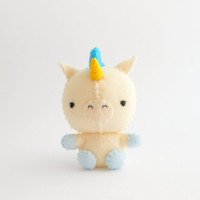 Unicorn soft sculpture with blue mane and golden horn