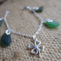 Scottish sea glass in green and clover charm bracelet, lucky bracelet with green sea glass, sterling silver bracelet and silver plated charm