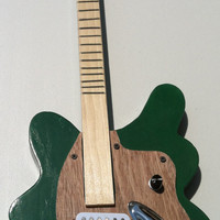 new (25 % off) Guitar on sale 3 stringed guitar and/or strings