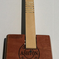 new (25 % off) Cigar Box Guitar on sale and/or strings